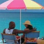 usvi_couple_under_umbrella_beach