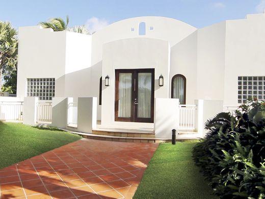 635998834169566970-OASIS-Villa-exterior-credit-CuisinArt-Golf-Resort-Spa.