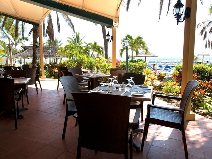 All-inclusive for singles, couples and families, the resort is also where you'll find authentic Antiguan fare on the menu at the airy Rainbow Garden. Photo Credit Elite Island Resorts