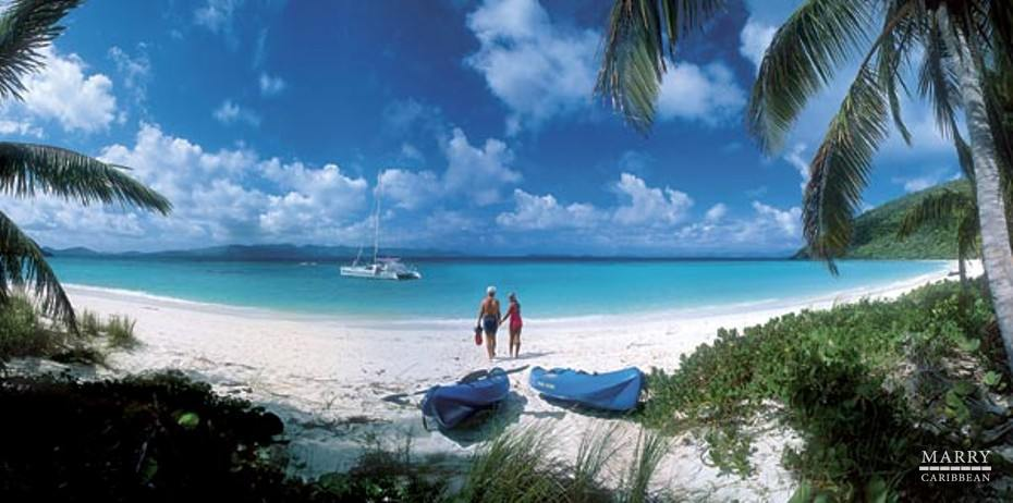 usvi couple on beach with yacht